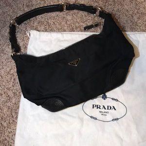 Black authentic Prada purse includes dust bag